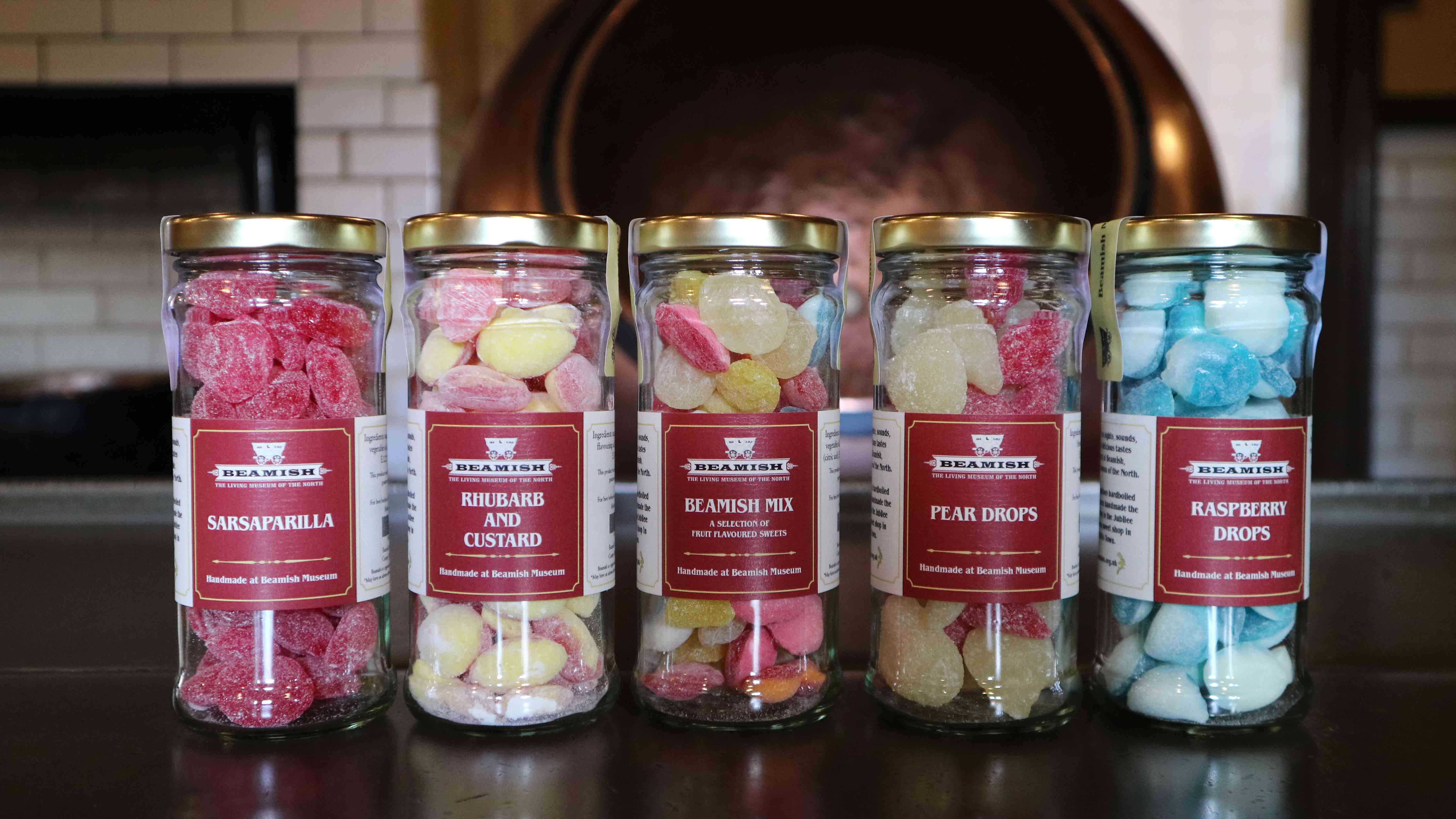 5 jars of hard boiled sweets in a row all with Beamish Museum branding on label.